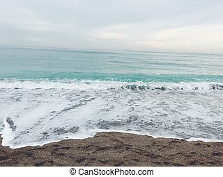 the horizon and the sea surf - sand, surf in the sea on the...