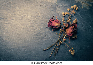 Closeup of Dry Rose Flower on Stone, Memory Love Conception