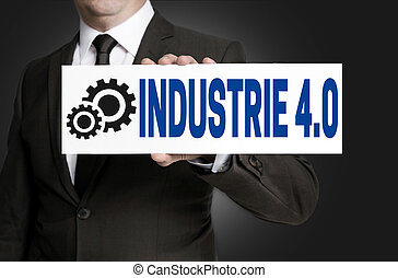 industrie 40 in german industry sign is held by businessman...