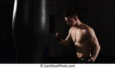 Self-defense. Young muscular athlete fulfills blows. boxing....