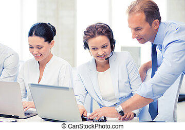 group of people working in call center - picture of group of...