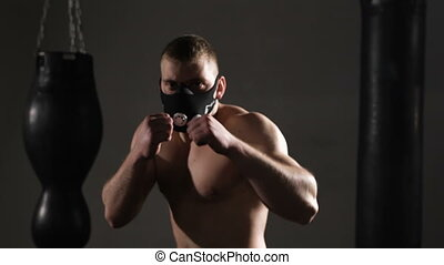 Intimidating shadow boxing Young athlete trains in the...