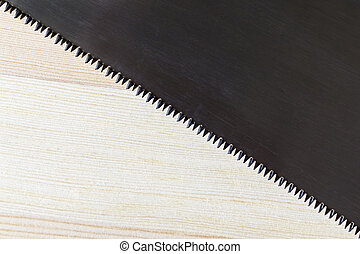 Hacksaw blade and wood plank texture background