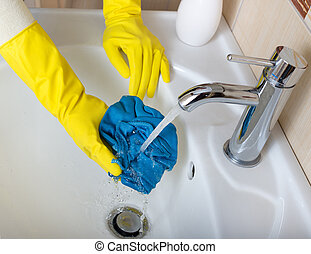 Cleaning bathroom sink - Close up of female hands with...