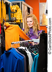 Beautiful woman in clothing store