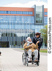 Disabled senior with carer - Image of disabled senior on...