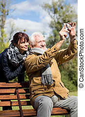 Elderly male taking photo - Image of elderly man taking...