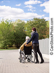 Man on wheelchair with nurse - Image of man on wheelchair...