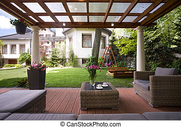 Gazebo with stylish garden furniture - Close-up of gazebo...