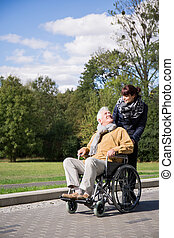 Disabled male on wheelchair trip - Photo of disabled man on...