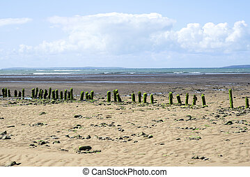 green algae covered wave breakers - wave breakers at the...