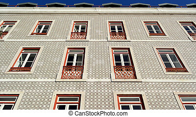 Detail of an old building with portuguese tiles and red and...