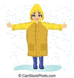 little girl in yellow raincoat in the rain stretching her...