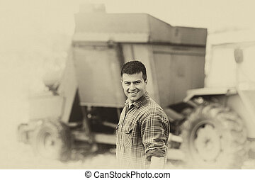 Sepia image of farmer with harvester - Vintage image of...