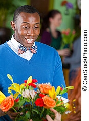 Male Flower Shop Customer - Handsome happy single African...
