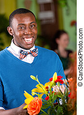Smiling Flower Shop Customer - Laughing handsome young adult...