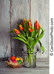 red tulips and plate with easter eggs