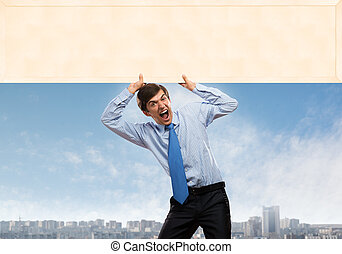 Businessman with blank banner - Emotional businessman...