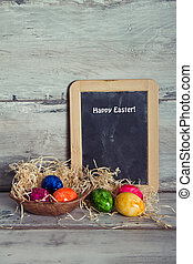 Blackboard and colored eggs