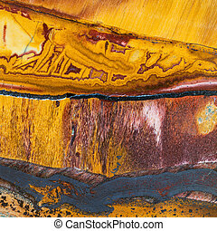 texture of Tiger's eye mineral gem stone close uo