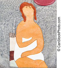 handmade leather applique - woman in towel sits on chair