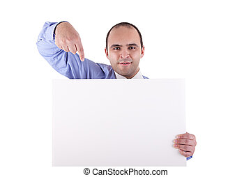 Young businessman holding a whiteboard and pointing, looking...