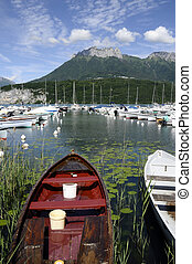 Fishing boats on Annecy lake, France - Landscape of Fishing...