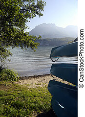 Canoes on Annecy lake, France - Canoes on Annecy lake and...