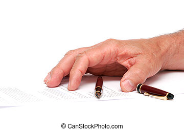 hand on a paper with a fountain pen