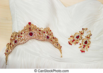 Bride golden crown with shining brilliants on wedding dress...