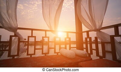 gazebo with sea view, sunset falling over the beach