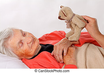 Eldery home care - Seniors woman with her caregiver at home