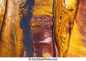 polished surface of Tiger's eye mineral gem stone