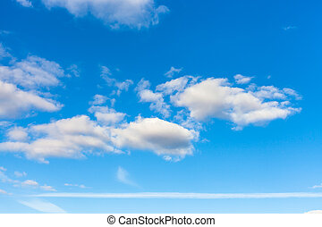 blue sky with clouds and horizontal airplane trail -...