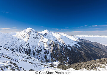 snow-capped mountains - mountain peaks covered with snow...