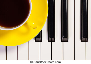 Piano keyboard and cup of coffee - Detail of piano keyboard...