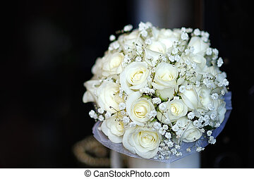 bridal bouquet of white roses on a dark background