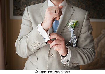 Close-up of elegance man hands with ring, necktie and...
