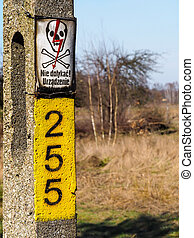 Power pole with sign of dananger.