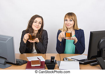 Tea Break two office employees at the desk - Two young...