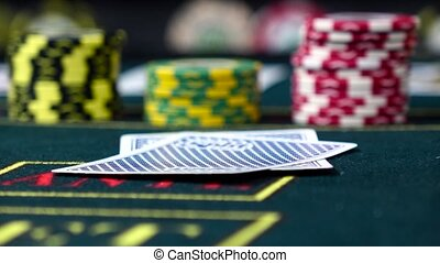 Player checks his cards playing poker, close up, front view...