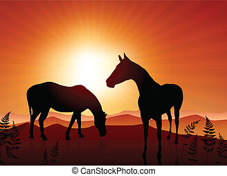 Horses grazing on sunset background