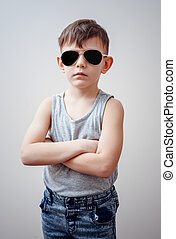 Boy with folded arms and sunglasses - Cute little single boy...