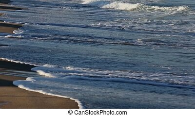 Sea Surf Waves on Sandy Beach - Sea surf waves on evening...