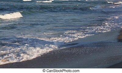 Sea Surf Waves on Sandy Beach. - Sea surf waves on sandy...