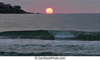 Rising Sun over Sea Horizon - Big yellow rising sun with red...
