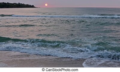 Rising Sun over Sea Horizon. - Rising sun with red edging...