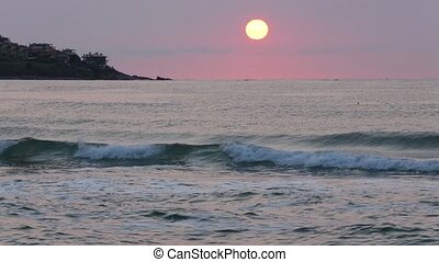 Rising Sun over Sea Horizon. - Big yellow rising sun with...
