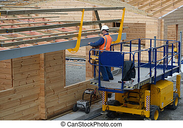 builders make it safe - A builder installs a safety guard...