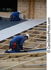 builders bang it home - Builders complete the roofing iron...
